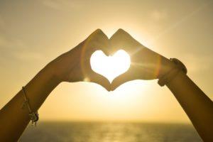 sunset hands love woman 300x200 -
